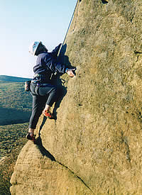 Climber on Big Chimney Arete at Burbage North